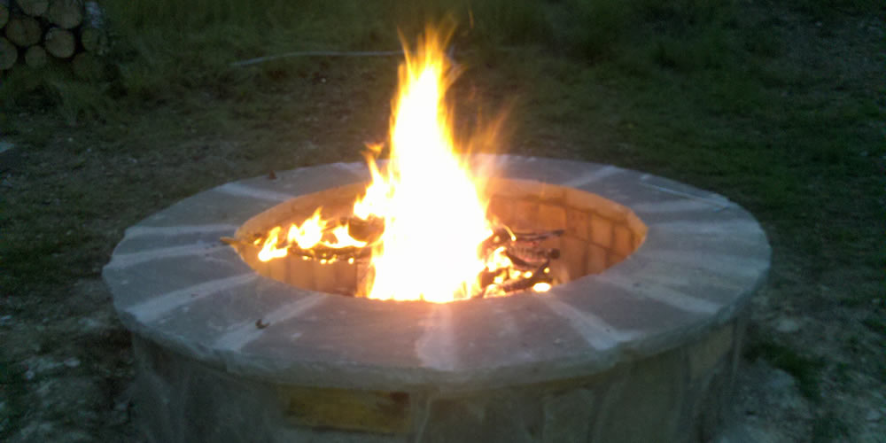 Firepit created and installed by Heritage Pools